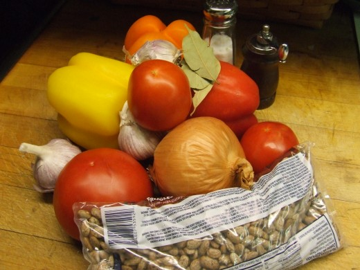 1 lb. bag of Pinto Beans,1 Large Onion, 3 cloves of fresh garlic, green and red pepper, bay leaves, vegetable or olive oil, water and salt and pepper.