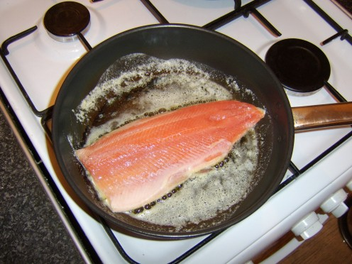 Pan frying the rainbow trout in butter