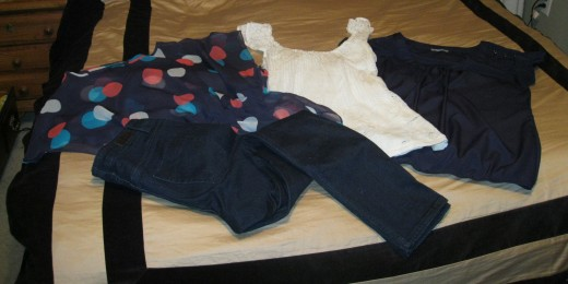 Skinny Jeans (dark denim), Cinched Waist Top (polka dots), Crocheted Top (ivory), and Studded Sleeve Top (navy blue)!