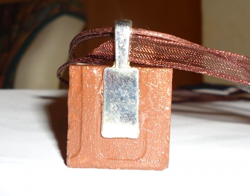 backside of tile pendant