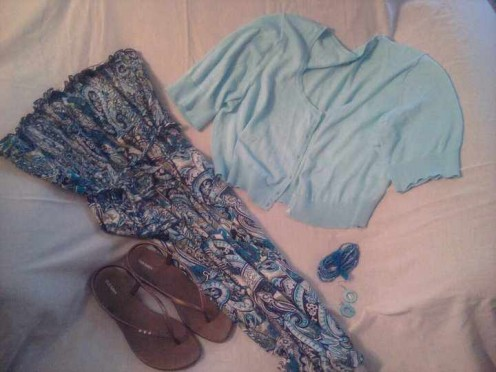 Set out all the pieces to an outfit.  Here I have a sundress, cropped sweater, dressy flip flops, bracelet group and earrings.