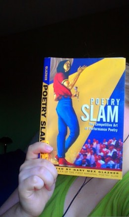 Ms. Sally reading Poetry Slam, the Competitive Art of Performance Poetry by Gary Mex Glazner.