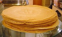 A whole stack of palačinke.   My plate never gets this high, they are usually salivating and ready to devour each fresh one that I produce.