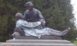 """Friend to Friend"" monument commemorating the fall of General Armistead and Captain Bingham as he listens to an inquiry regarding General Hancock"