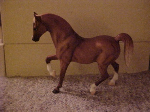 This model's left front leg goes out at an angle that would get it marked down at a model horse show. It needs to be brought back.