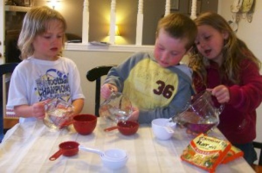 Children engaged in kitchen science