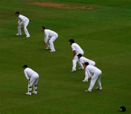 The wicketkeeper and a full slip cordon.