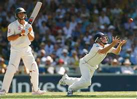 Adam Gilchrist is caught at short leg.