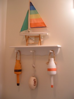 Hand Painted Craft Buoys Hanging From  Our Bathroom Shelf