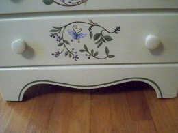 Right down to the bottom edges a border detail adds a finishing touch to the painted dresser.