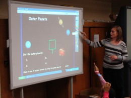 Teacher guided instruction using a Promethean Board.