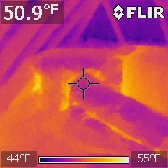 A thermal image of an attic air handling unit for a central air conditioning system.