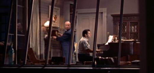 Hitchcock made one of his famed cameo appeances standing in the apartment of a composer across the way.