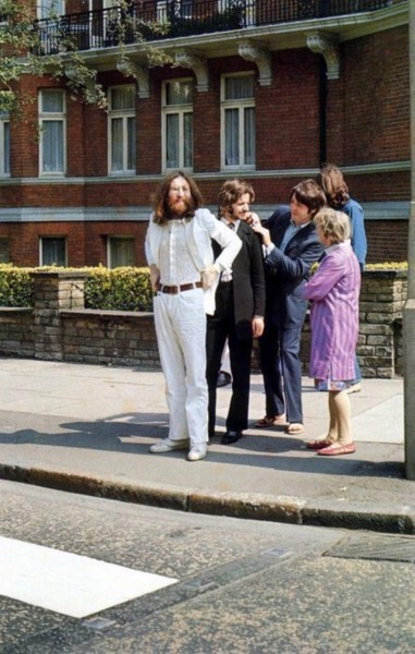 When looking at this picture, it is easy to see that The Beatles are just like us. They look normal, even if this is the scene right before taking the famous Abbey Road picture.