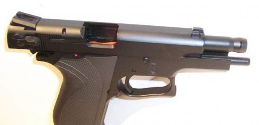 Examples of handguns with their actions open and empty. Note that you can see the orange magazine follower in the semi-auto. This indicates that the magazine is empty.