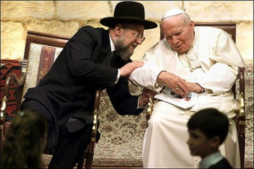 Chief Rabbi Israel Lau leaned in to speak to Pope John Paul II during the pope's historic visit to the Western Wall in Jerusalem on March 23, 2000.