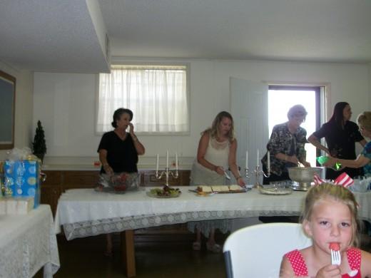 The Hostesses serving snacks.
