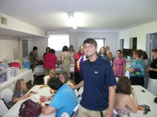 The groom to be,Drake Oliver being silly while the guests are being served food.