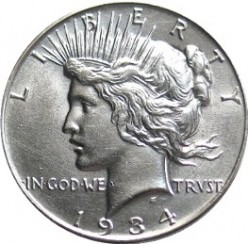 The front of the coin shows Liberty in all her glory!
