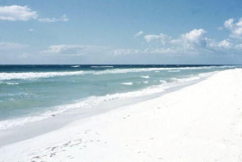 White sand beaches and colorful Gulf waters.
