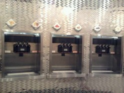 Silver wall that is filled with a dozen choices of frozen live culture yogurt from which to choose!