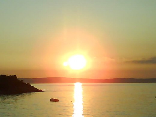 Insel Rab, Croatia - My children were inspired taking pictures from the exotic rarely amazing sunset as our dinner arrived.