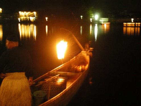 A cormorant fishing boat, or ubune (c) A Harrison