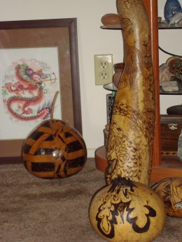 this is a huge gourd with cut out work and a huge Dragon wrapped all around it