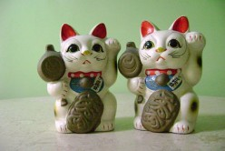 Japanese Maneki Neko fortune cats with Golden Hammer and Daruma Doll