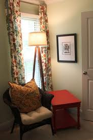 Nice color scheme but there's way too much going on here: red table too big, lamp too tall, just too much stuff