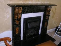 Painting this area white only serves to draw attention to this ugly fireplace