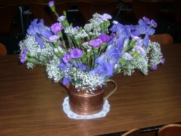 A variety of flowers can make a nice arrangement. Carnations, Babies breathe and Irises make a pretty monochromatic bouquet. I used a copper watering can as a vase.