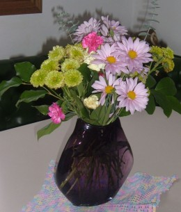 Mixed flowers can make a nice arrangement. This  bouquet would look more interesting if the flowers were intermingled more.
