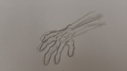 Extra details sketched in on the hand.