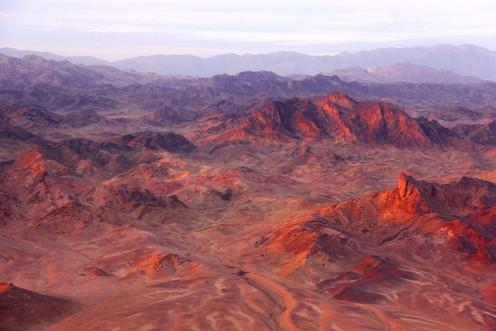 Sunset lights the mountains afire near Musa Qaleh