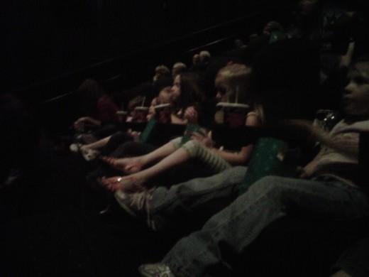Watching a movie & enjoying popcorn!