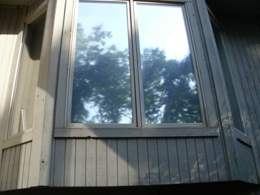 Tinted window outside view, note the reflective quality compared to the untinted window