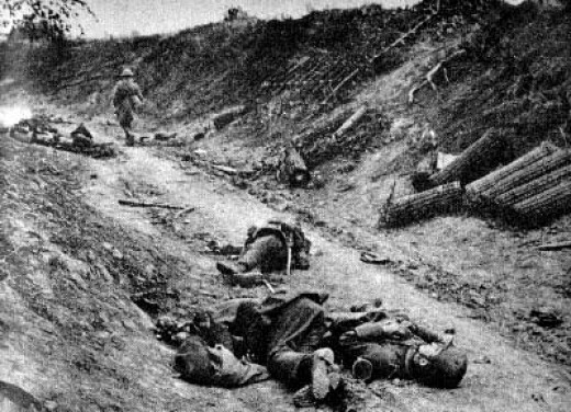 Dead soldiers laying on a road