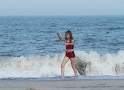 Our granddaughter sand surfing at Cape Hatteras National Seashore. Parents should be aware that rip currents are dangerous even in shallow water. Watch where children play!