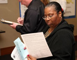 Unlike the FEMA form this New Orleans lady is scrutinizing, my survey is only 7 questions!