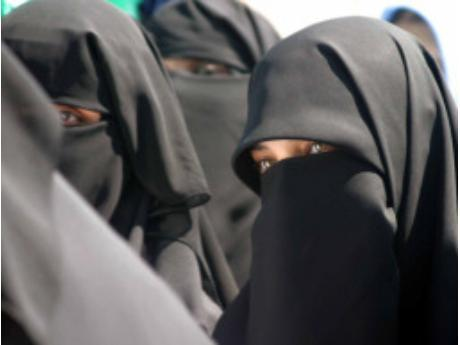 Moroccan Muslim Women wearing traditional clothes - the Niqab or Burqa as it is famously known