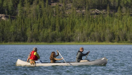 The Royal couple paddle a canoe with Fort Smith's village elder Francois Paulette while visiting Blatchford Lake, Northwest Territories