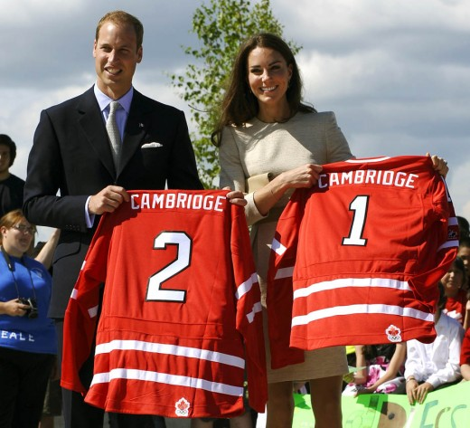 The Duke and Duchess receive hockey jerseys during a street hockey event at the Somba K'e Civic Plaza in Yellowknife