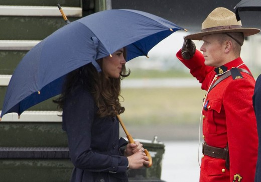 The Duchess is saluted by a Royal Canadian Mounted Police officer upon her arrival in Yellowknife, Northwest Territories on July 4, 2011