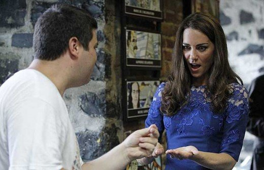 The Duchess takes part in a trick during a tour of the Maison Dauphine in Quebec City