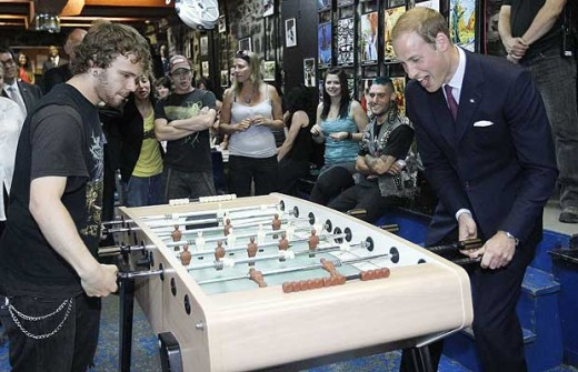 Prince William plays foosball during a tour of the Maison Dauphine in Quebec City July 3, 2011