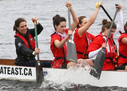 The Duchess has her eyes on the finish line as takes on William in a dragon boat race on Lake Dalvay. William won.