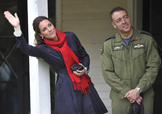 Kate waves to William as he takes part in Sea King helicopter demonstration in Dalvay by the Sea