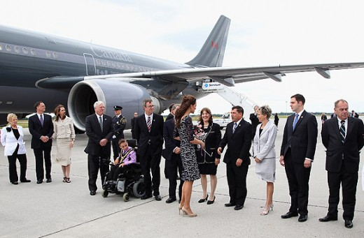 The Duchess greets people in the line-up as she arrives at Macdonald-Cartier International Airport in Ottawa