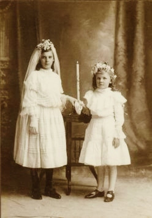 My grandmother's First Holy Communion photo taken with her little cousin in attendance.